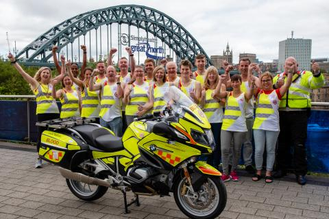 Team Blood Bikes runners in front of the Tyne bridge