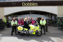 Alan Johnston, Alex McDonald, Dave Hayles, Marc Proctor, Paul Travis Anderson, Walter Irvine, Dean Rookes, Sarah Garbutt, Sean Jamieson and Audrey Garton sat on the Blood Bike.